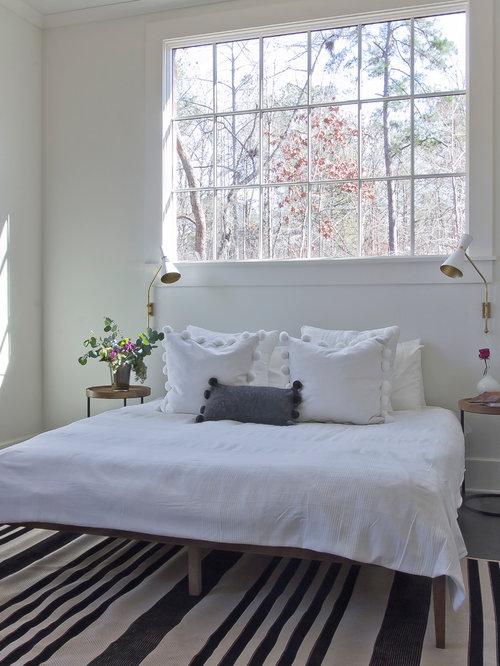 Mittelgroßes Skandinavisches Schlafzimmer Ohne Kamin, Im Loft Style Mit  Weißer Wandfarbe Und Betonboden In