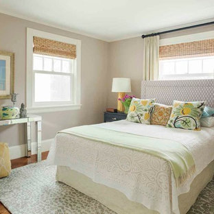 Small transitional guest medium tone wood floor bedroom photo in Boston with beige walls