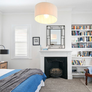Design ideas for a transitional guest bedroom in Sydney with white walls, carpet, a standard fireplace, grey floor and a metal fireplace surround.