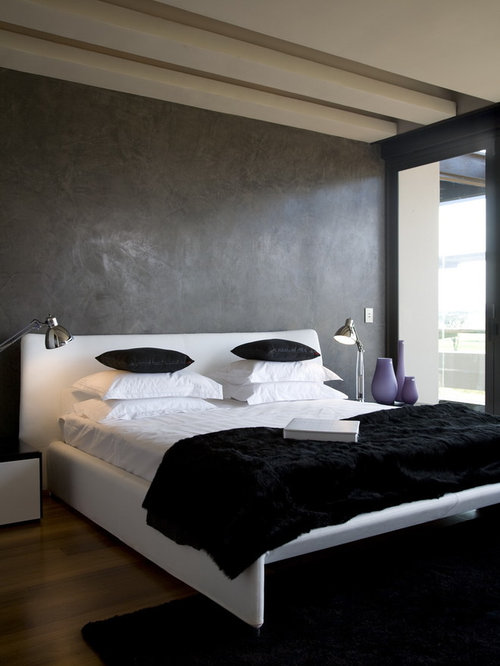 Example Of A Trendy Dark Wood Floor And Brown Floor Bedroom Design With  Brown Walls