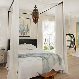 Large eclectic master light wood floor bedroom photo in San Francisco with white walls