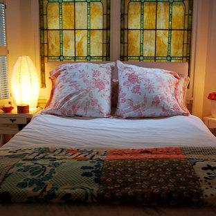 Eclectic bedroom photo in San Francisco with beige walls