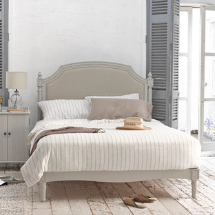 Example of a cottage chic bedroom design in London