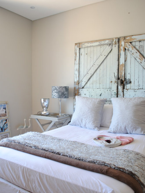 Inspiration for a shabby-chic style bedroom remodel in Other with beige  walls - Barn Door Headboard Houzz