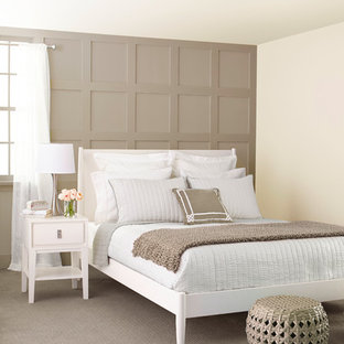 Inspiration for a mid-sized transitional master carpeted bedroom remodel in Charlotte with brown walls