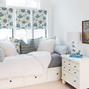 This is an example of a small traditional guest bedroom in Toronto with white walls, carpet, no fireplace and beige floors.