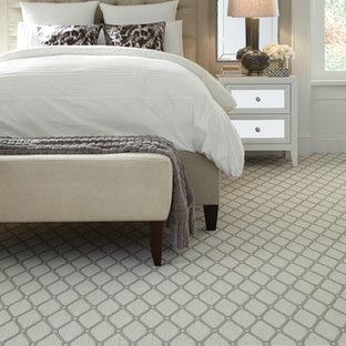 Inspiration for a large transitional master bedroom in New York with grey walls and carpet.