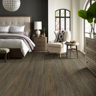 Inspiration for a mid-sized transitional master dark wood floor and brown floor bedroom remodel in Orange County with beige walls and no fireplace