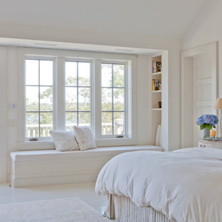 Example of a coastal white floor bedroom design in New York with white walls