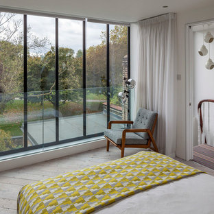 Bedroom - mid-sized modern master light wood floor and white floor bedroom idea in London with white walls and no fireplace