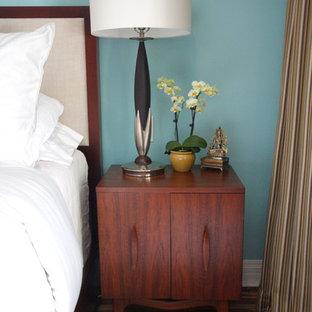 Bedroom - eclectic bamboo floor bedroom idea in Los Angeles with blue walls