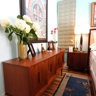 Eclectic bamboo floor bedroom photo in Los Angeles with blue walls