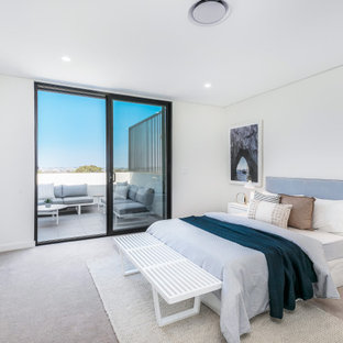 Design ideas for a contemporary master bedroom in Sydney with white walls, carpet, no fireplace and grey floor.