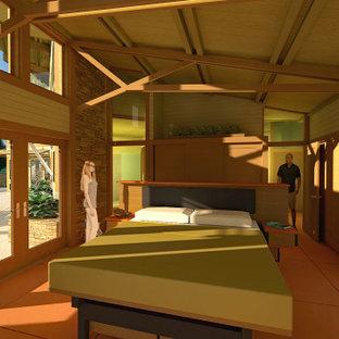 Diseño de dormitorio principal y madera, contemporáneo, de tamaño medio, madera, sin chimenea, con paredes multicolor, suelo de cemento, suelo rojo y madera