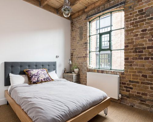 This is an example of a medium sized industrial guest bedroom in London  with carpet. Industrial Bedroom Design Ideas  Pictures   Inspiration