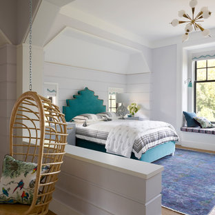 Coastal Guest Medium Tone Wood Floor And Brown Floor Bedroom Photo In Other  With Purple Walls