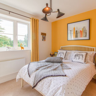 Inspiration for a traditional bedroom in Gloucestershire with yellow walls, carpet and beige floors.