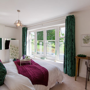 Design ideas for a medium sized contemporary bedroom in Gloucestershire with white walls, carpet, no fireplace and beige floors.