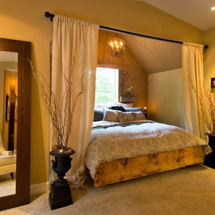 Example of a tuscan carpeted bedroom design in New York with no fireplace