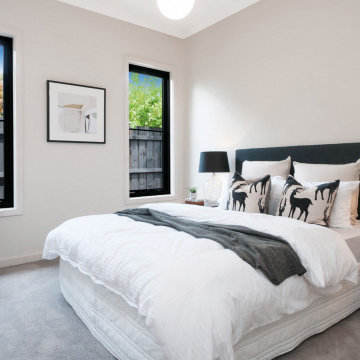 Two Aluminium Awning Windows in a bedroom