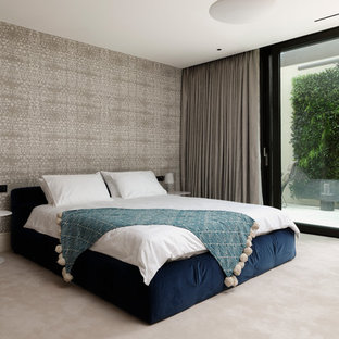 Inspiration for a large contemporary guest carpeted and beige floor bedroom remodel in London with beige walls