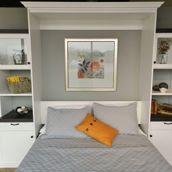 """Showroom Wall Bed - This queen size wall bed is on display in our Fort Worth showroom. It represents everything we love about wall beds. This is one of the most functional pieces of furniture you can buy. Turn any space into a very comfortable bedroom while taking up less than 9 square feet of floor space while the bed is upright. This melamine unit in Arctic White uses bead board fronts and heavy 2"""" thick tops in a textured wood grain to balance out the white. This display uses 3/4"""", 1 1/8"""" and 2"""" thick materials, shows 2 different edge band options as well as open and solid back panels. The slide out tables on either side give guests even more usable space during their visit. Storage can also be designed to hold your guests clothing while they stay so that you can keep your closets separate."""