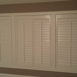 Shutters - After photo of Master Bedroom with Hunter Douglas Newstyle Hybrid Shutters! An economically priced composite wood shutter available in many shapes, styles and colors.