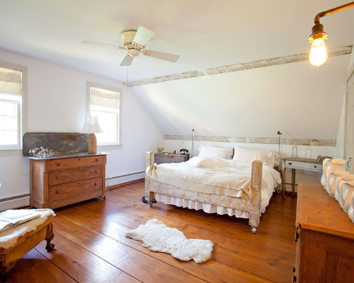 Superb Farmhouse Medium Tone Wood Floor Bedroom Idea In Boston With White Walls
