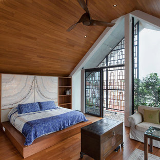 Inspiration for a large contemporary bedroom in Singapore with medium hardwood flooring.