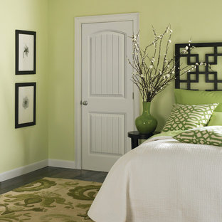 Bedroom - small contemporary guest dark wood floor bedroom idea in Chicago with green walls and no fireplace