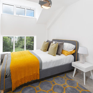 This is an example of a contemporary bedroom in Cheshire with white walls, carpet and grey floors.