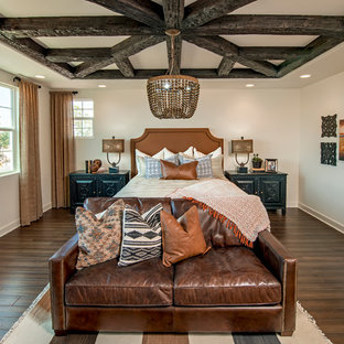 Inspiration for a southwestern dark wood floor bedroom remodel in Orange County with white walls