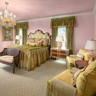 This is an example of an expansive traditional guest bedroom in Dallas with pink walls, carpet and beige floor.