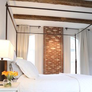 На фото: хозяйская спальня среднего размера с серыми стенами, деревянным полом и бирюзовым полом без камина