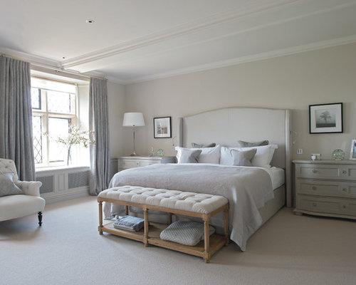 design ideas for an expansive country master bedroom in gloucestershire with carpet and grey walls - Bedroom Design Ideas