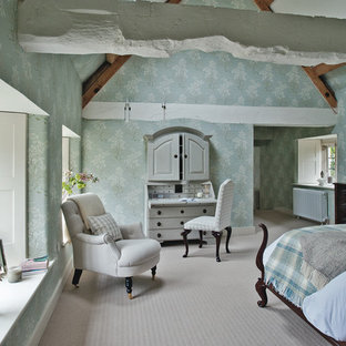 Inspiration for a large cottage master carpeted bedroom remodel in Gloucestershire with blue walls
