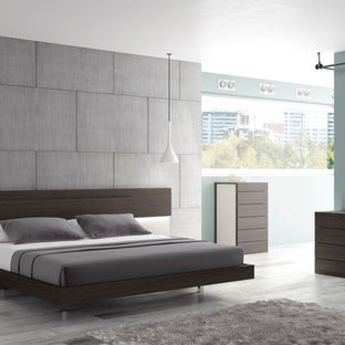 Inspiration for a mid-sized contemporary bedroom remodel in Los Angeles with gray walls