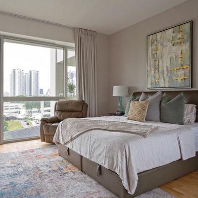 Bedroom - contemporary light wood floor and beige floor bedroom idea in Singapore with beige walls