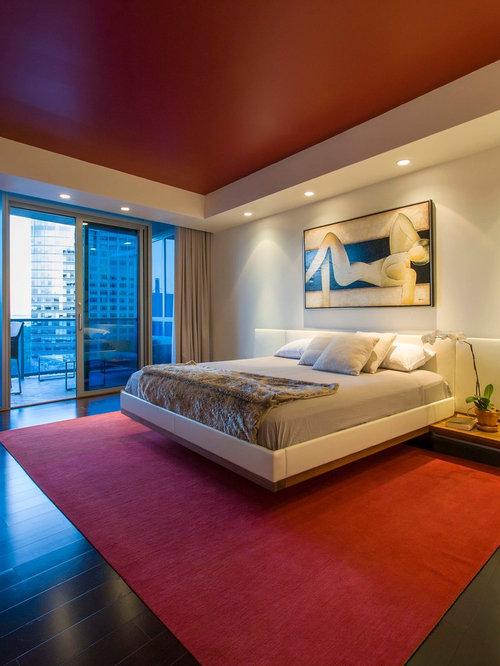 red bedroom design ideas renovations photos with dark hardwood