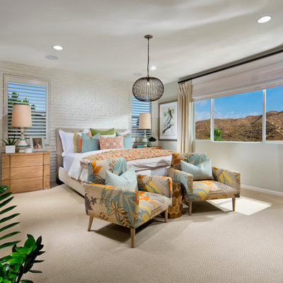 Inspiration for a tropical carpeted bedroom remodel in Orange County with gray walls
