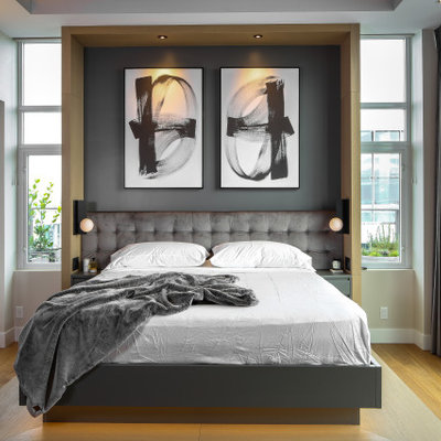 Inspiration for a mid-sized contemporary master medium tone wood floor and brown floor bedroom remodel in Vancouver with beige walls