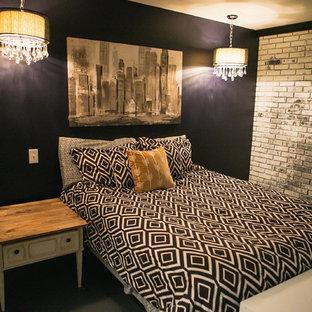 Foto de dormitorio principal, bohemio, de tamaño medio, con paredes azules, suelo de cemento, chimenea tradicional y marco de chimenea de ladrillo