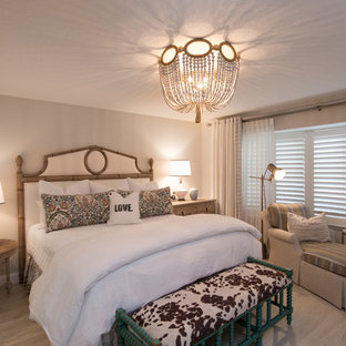 Example of a transitional master light wood floor bedroom design in Miami with gray walls