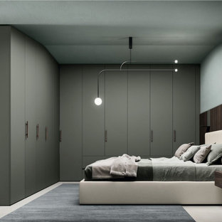 Bedroom - small contemporary guest bedroom idea in New York with gray walls