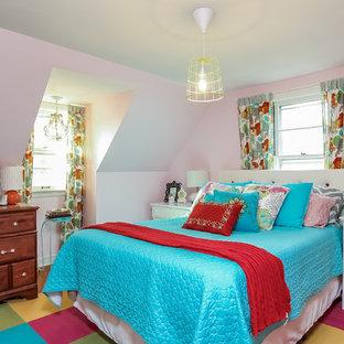 Example of a small eclectic master dark wood floor bedroom design in Grand Rapids with pink walls