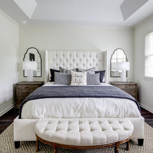 Design ideas for a mid-sized traditional master bedroom in Atlanta with grey walls, medium hardwood floors and brown floor.