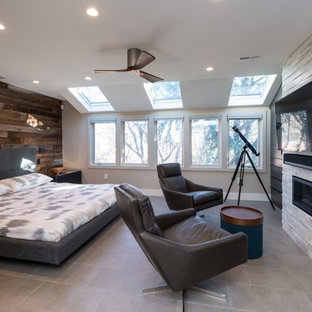 Inspiration for a contemporary beige floor bedroom remodel in Philadelphia with brown walls and a standard fireplace