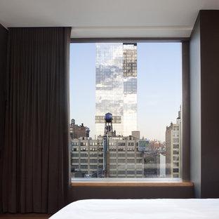 Minimalist bedroom photo in San Francisco with gray walls