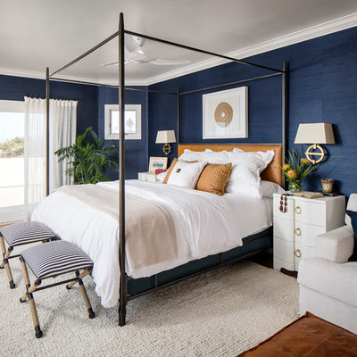 Example of a mid-sized beach style master bedroom design in San Francisco with blue walls
