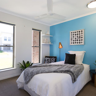 Inspiration for a transitional bedroom in Brisbane with blue walls and no fireplace.